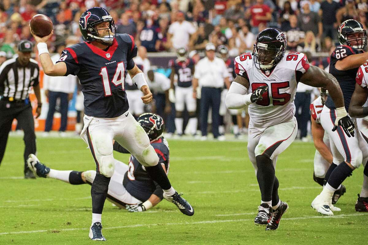 Houston Texans quarterback Ryan Fitzpatrick scrambles away from Atlanta Falcons defensive tackle Jonathan Babineaux to throw a touchdown pass to wide receiver DeVier Posey during the second quarter of a preseason football game on Saturday, Aug. 16, 2014, in Houston.