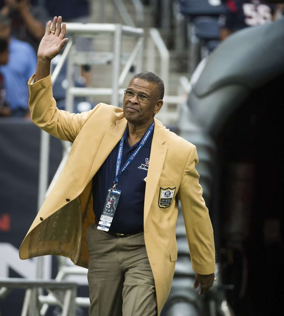 Hall of Fame defensive back Kenny Houston of the Houston Oilers is introduced before the Houston Texans face the Atlanta Falcons in a preseason football game on Saturday, Aug. 16, 2014, in Houston. ( Smiley N. Pool / Houston Chronicle )