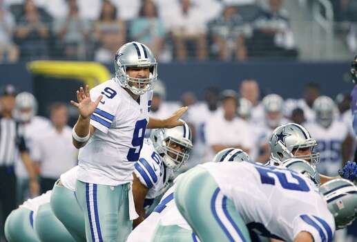 Dallas Cowboys quarterback Tony Romo (9) in action against the Baltimore Ravens during the first half of an NFL preseason football game Saturday, Aug. 16, 2014, in Arlington, Texas. (AP Photo/Kiichiro Sato) Photo: Kiichiro Sato, Associated Press / AP