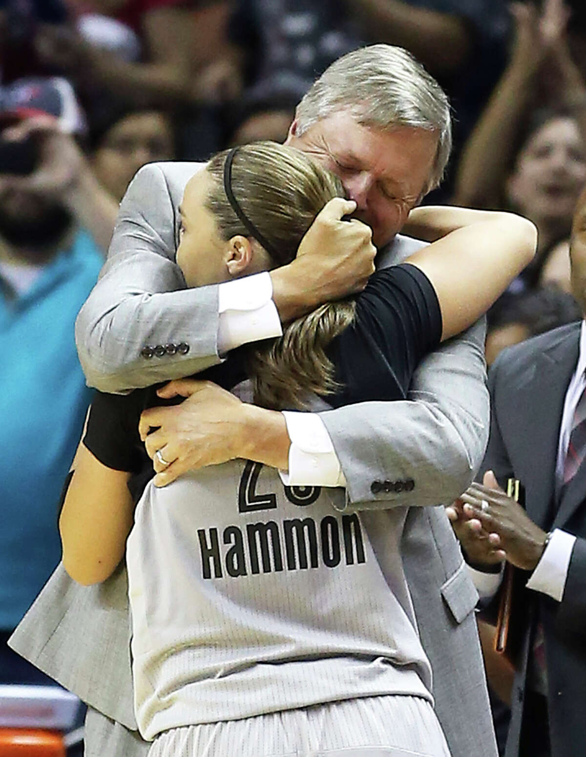 Becky Hammon gets a hug from head coach Dan Hughes as she exits the game as the Stars play the Minnesota Lynx in the last regular season home game of the year on August 15, 2014.