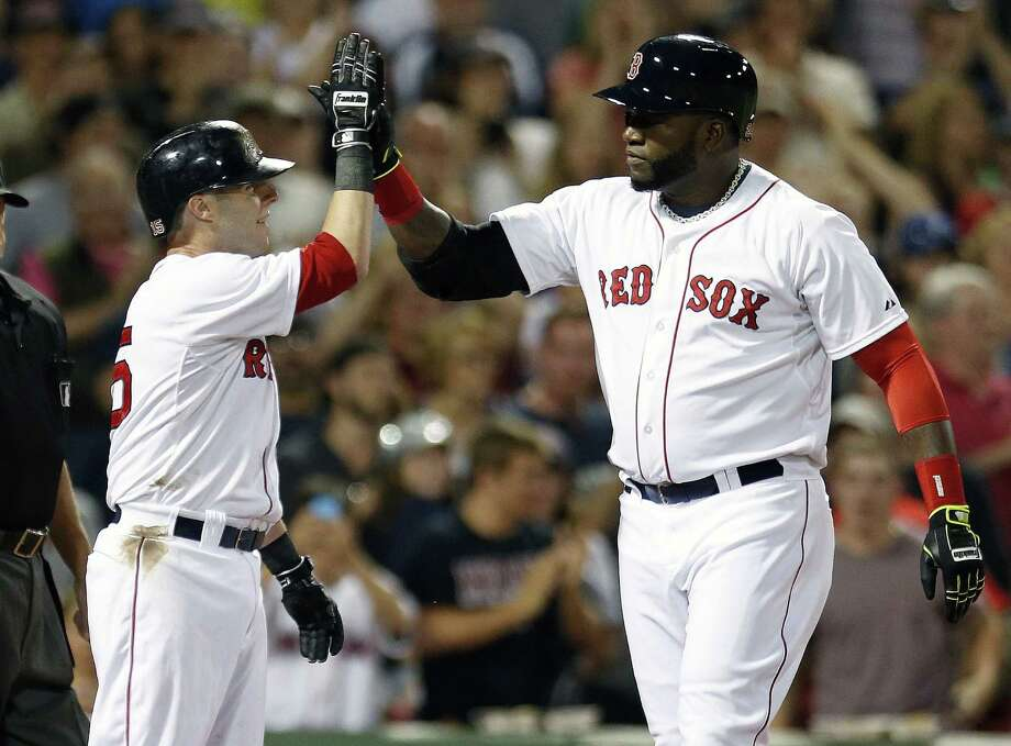Boston's David Ortiz (right) is congratulated by Dustin Pedroia after his two-run homer, his 400th in a Red Sox uniform, helped take down Houston on Saturday night at Fenway Park. Photo: Michael Dwyer / Associated Press / AP