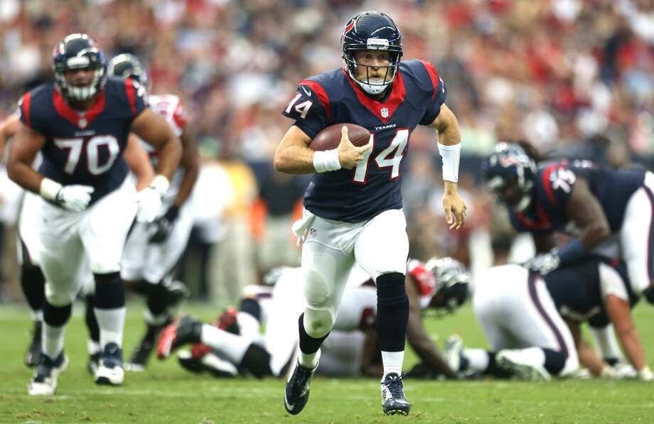 Texans 32, Falcons 7 Texans quarterback Ryan Fitzpatrick runs for a first down. Photo: Brett Coomer, Houston Chronicle