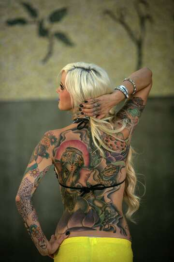 Erin shows her ink during the 13th annual seattle tattoo for Seattle sounders tattoo
