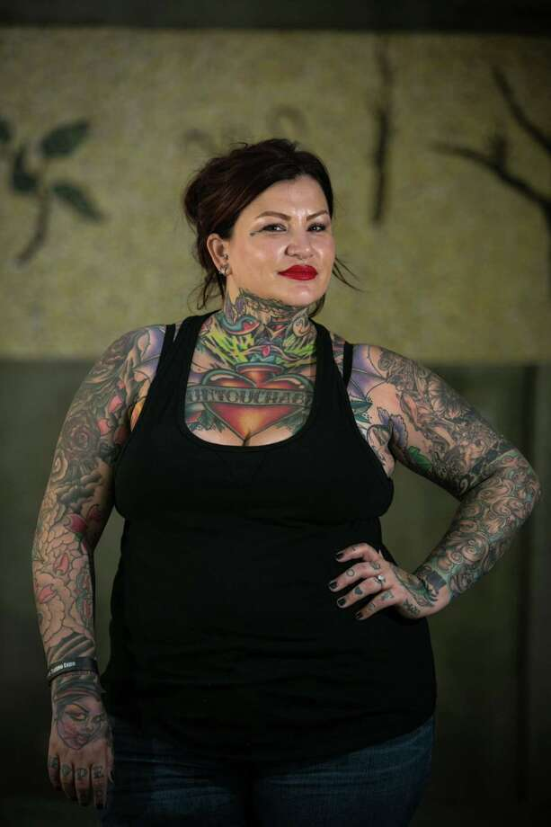 Mel Carroll shows her ink during the 13th annual Seattle Tattoo Expo at Fisher Pavilion at the Seattle Center. Photographed on Sunday, August 17, 2014. Photo: JOSHUA TRUJILLO, SEATTLEPI.COM / SEATTLEPI.COM