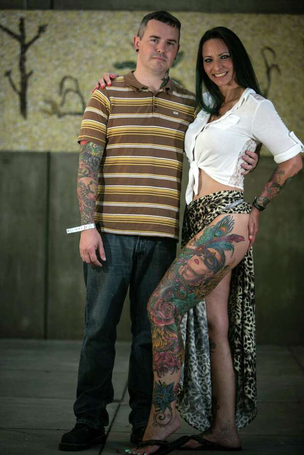 Corrina Drake shows her ink with tattoo artist Mike Tidwell during the 13th annual Seattle Tattoo Expo at Fisher Pavilion at the Seattle Center. Photographed on Sunday, August 17, 2014. Photo: JOSHUA TRUJILLO, SEATTLEPI.COM / SEATTLEPI.COM
