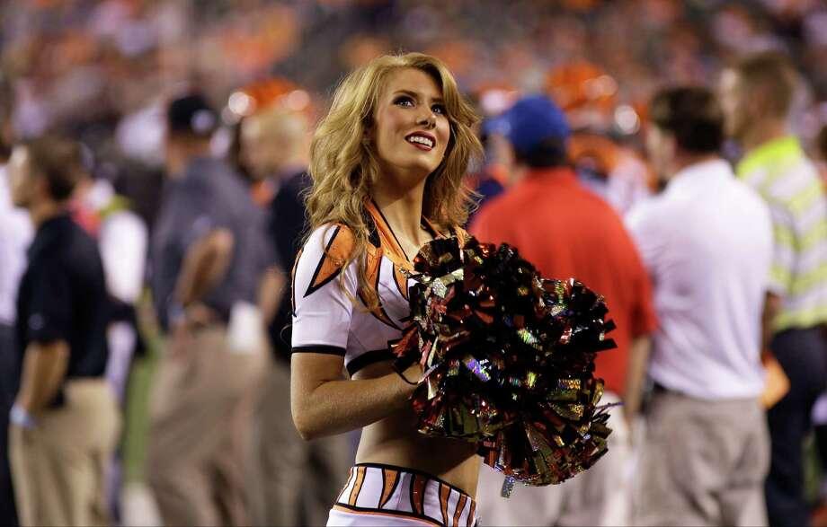 A Cincinnati Bengals cheerleader on Aug. 16, 2014. Photo: Tony Tribble, Associated Press / FR66264 AP