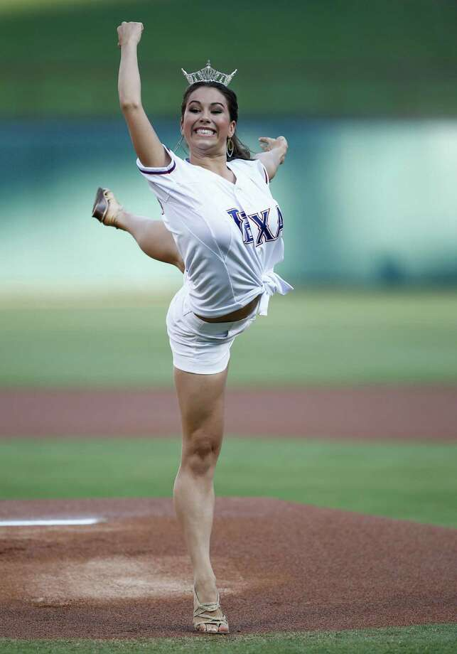 Miss Texas 2014 Monique Evans poses after throwing out the ceremonial first-pitch before the baseball between the Los Angeles Angels and the Texas Rangers, Friday, Aug. 15, 2014, in Arlington, Texas. (AP Photo/Jim Cowsert) Photo: Jim Cowsert, Associated Press / FR170531 AP