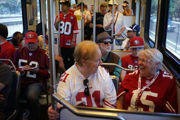 Mae Hendon, left, and Nathalie Pataky share a moment on the VTA Lightrail on Sunday, Aug. 16, 2014 in Santa Clara, Calif. 49ers fans came from all over the Bay Area to attend the first game at the Levi's Stadium.