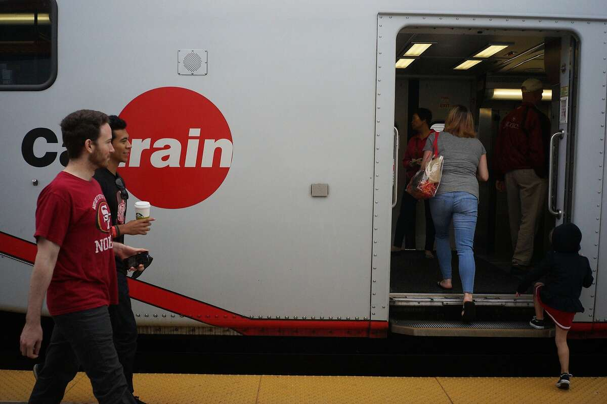 Commuters board the Caltrain at the San Francisco station on Sunday, Aug. 16, 2014 in San Francisco, Calif.
