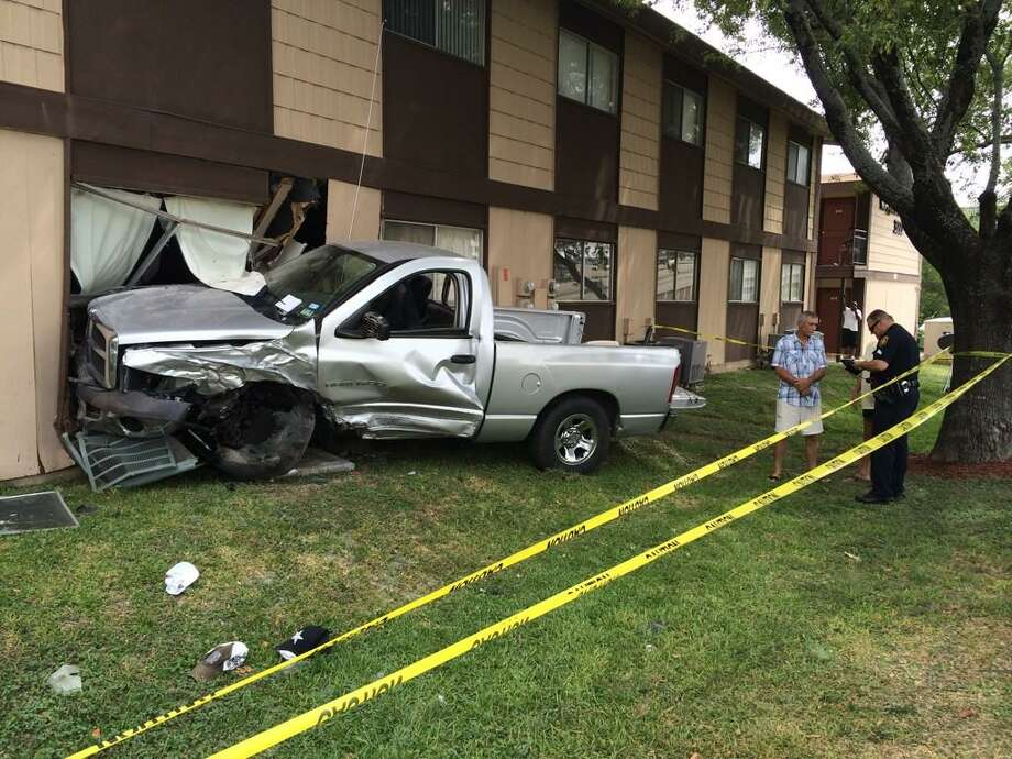 San Antonio police say a man suspected of driving a stolen truck lost control and crashed into an apartment on the Northwest Side Sunday afternoon, Aug. 17, 2014. Photo: Drew Joseph/San Antonio Express-News