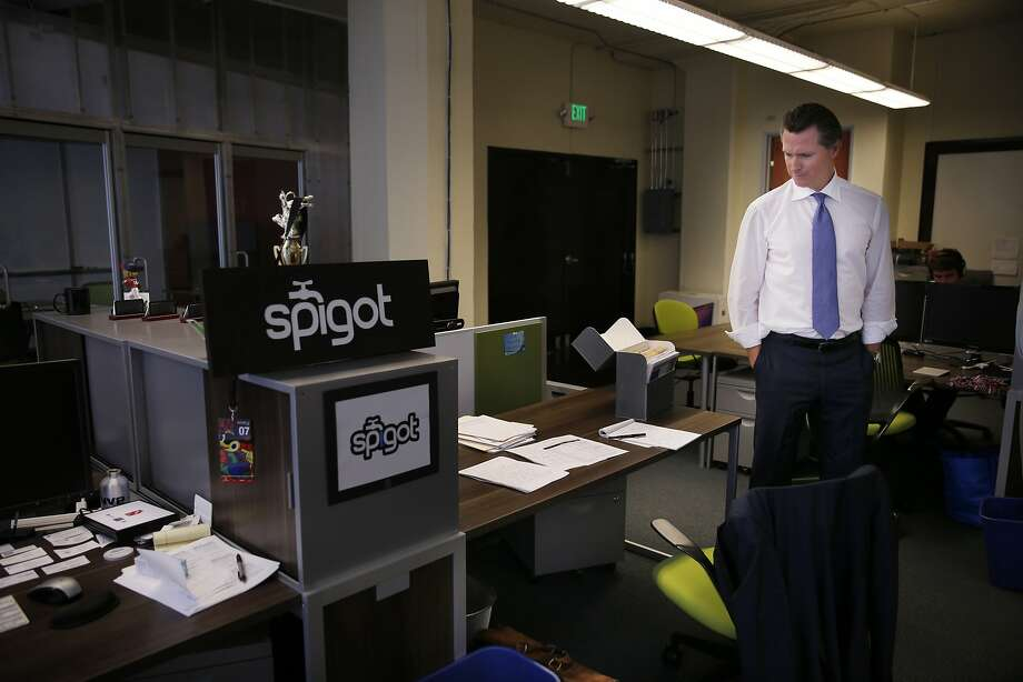 Lt. Gov. Gavin Newsom has one desk in the office space he shares with startup Spigot at the S.F. Founders Den, where space is much cheaper than in Sacramento. He says headphones help block out noise. Photo: Lea Suzuki, The Chronicle