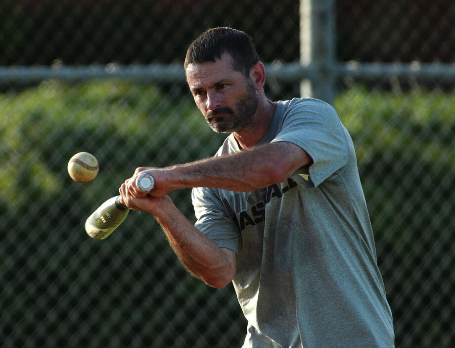 "Coach Mike Hiltz bats a ball out to players in the infield during practice Thursday. The Nederland Babe Ruth 13-year-olds team practiced at R.L. ""Bob"" Harmon Park on Thursday afternoon. The team is headed to the Babe Ruth World Series in Glen Allen, Virginia, next week. Photo taken Thursday 8/7/14 Jake Daniels/@JakeD_in_SETX Photo: Jake Daniels / ©2014 The Beaumont Enterprise/Jake Daniels"
