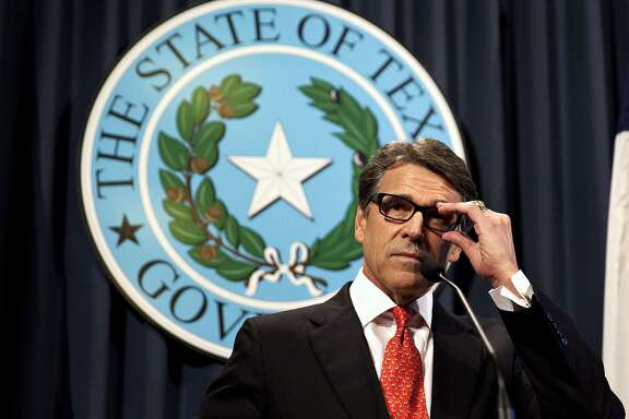 Gov. Rick Perry makes a statement at the capitol building in Austin, Texas on Saturday, Aug. 16, 2014 concerning the indictment on charges of coercion of a public servant and abuse of his official capacity. Perry is the first Texas governor since 1917 to be indicted. (AP Photo/The Daily Texan, Mengwen Cao)