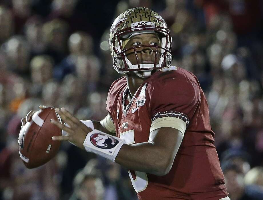 Top-ranked Florida State again will have Jameis Winston at quarterback. He won the Heisman Trophy last season. Photo: David J. Phillip, Associated Press