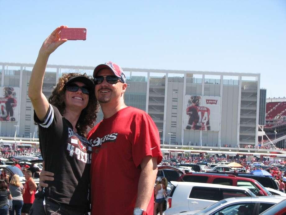 Miranda and Dan Helmer of Pleasanton take a selfie before Sunday's game.