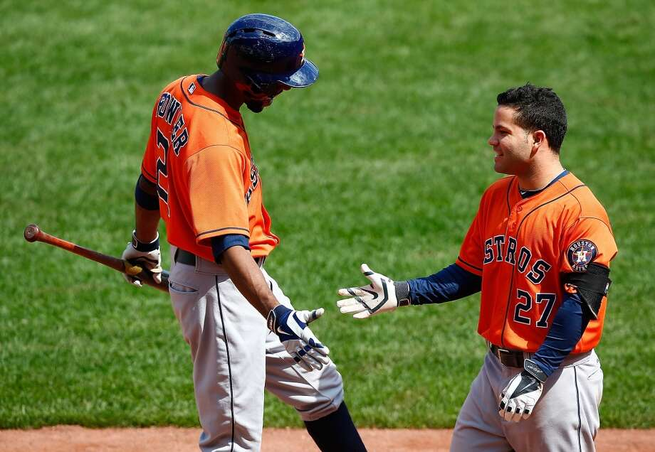 August 17: Astros 8, Red Sox 1Jose Altuve celebrates with teammate Dexter Fowler following his grand slam in the second inning. Photo: Jared Wickerham, Getty Images