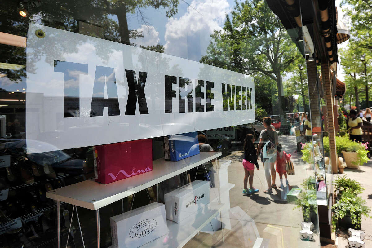 A sign advertising tax-free week is displayed in the storefront of Shoes 'N' More during the start of tax-free week for school shopping in Greenwich, Conn., on Sunday, Aug. 17, 2014.