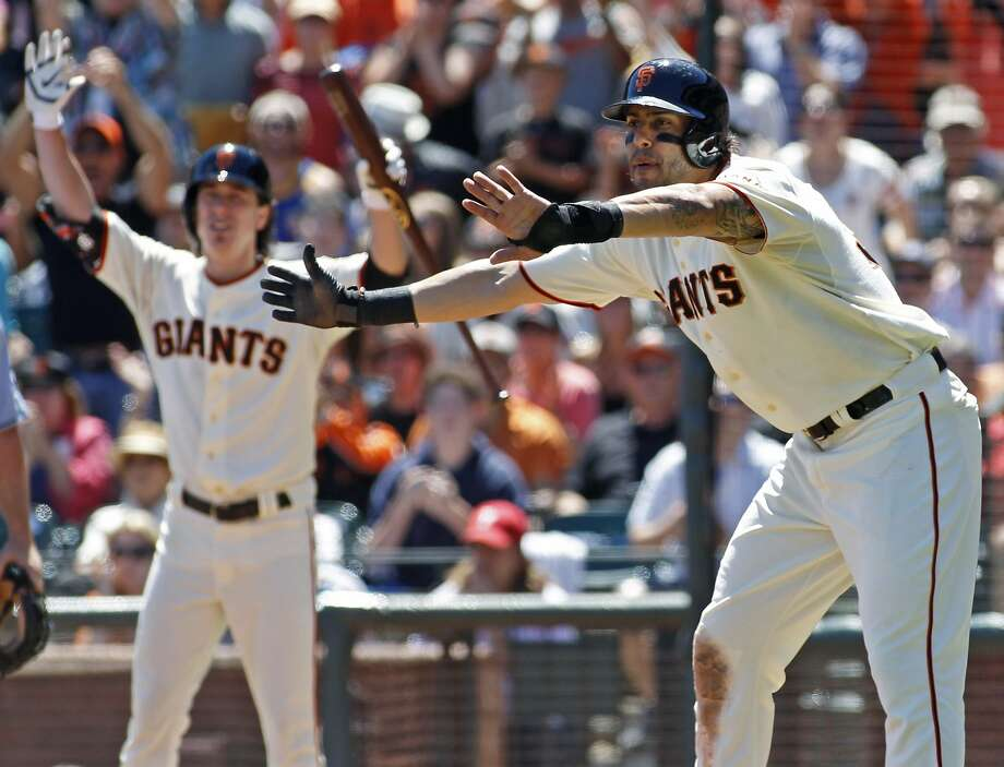 Michael Morse (right) and Tim Lincecum react while watching Andrew Susac score on a throwing error for a 2-1 lead after Brandon Crawford's RBI single in the second inning. Photo: George Nikitin, Associated Press