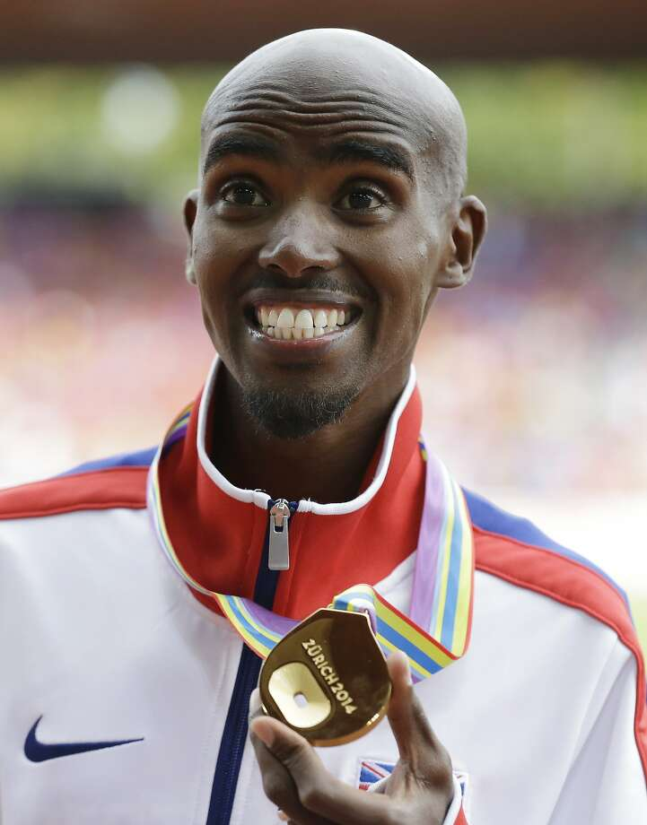Britain's Mo Farah sports his gold medal during the ceremony for the men's 5000m final during the European Athletics Championships in Zurich, Switzerland, Sunday, Aug. 17, 2014. (AP Photo/Matt Dunham) Photo: Matt Dunham, Associated Press