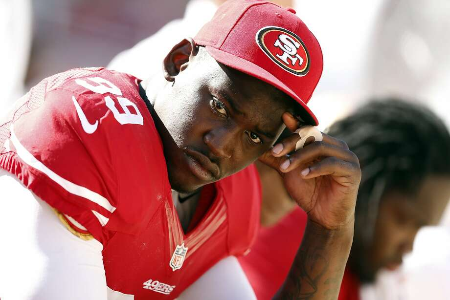 San Francisco 49ers' Aldon Smith sits on bench in final minutes of 34-0 loss to Denver Broncos during NFL preseason game at Levi's Stadium in Santa Clara, Calif. on Sunday, August 17, 2014. Photo: Scott Strazzante, The Chronicle