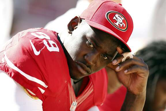 San Francisco 49ers' Aldon Smith sits on bench in final minutes of 34-0 loss to Denver Broncos during NFL preseason game at Levi's Stadium in Santa Clara, Calif. on Sunday, August 17, 2014.