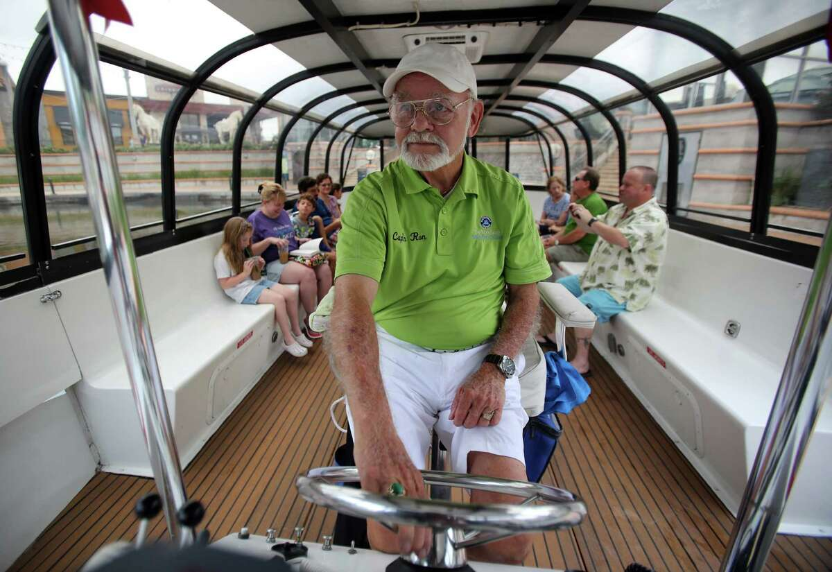 Captain Ron Bauer maneuvers a water cruiser through the canals in The Woodlands. The water taxi service provides access to area businesses and connects to a fixed-route trolley with stops around Town Center.