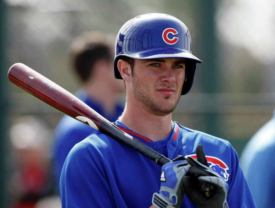 FILE - In this Feb. 21, 2014, file photo, Chicago Cubs third baseman Kris Bryant (77) takes batting practice during spring training baseball practice in Mesa, Ariz. Every time top Cubs prospect Kris Bryant hits a home run, proud papa Mike Bryant beams back home in Las Vegas.   (AP Photo/Rick Scuteri, File) Photo: Rick Scuteri, FRE / FR157181 AP