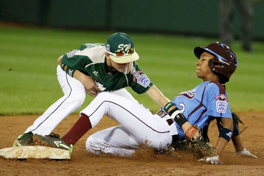 Philadelphia's Mo'ne Davis is safe at second as the ball falls out of the glove of Pearland second baseman Bryce Laird during the third inning of a baseball game in United States pool play at the Little League World Series tournament in South Williamsport, Pa., Sunday, Aug. 17, 2014. Davis advanced to second on a fielder's choice by Philadelphia's Kai Cummings. (AP Photo/Gene J. Puskar Photo: Gene J. Puskar, Associated Press / AP