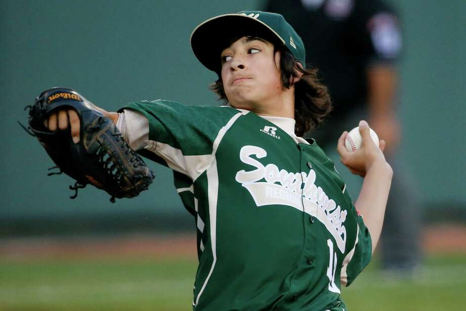 Pearland pitcher Clayton Broeder delivers during the first inning of a baseball game against Philadelphia at the Little League World Series tournament in South Williamsport, Pa., Sunday, Aug. 17, 2014. (AP Photo/Gene J. Puskar) Photo: Gene J. Puskar, Associated Press / AP