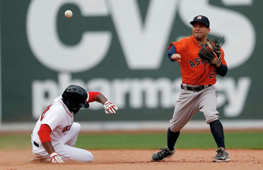 After providing the big hit with a second-inning grand slam, Jose Altuve does his part in the field by turning a sixth-inning double play well ahead of the slide by Red Sox outfielder Jackie Bradley Jr. Photo: Michael Dwyer, STF / AP