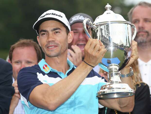 GREENSBORO, NC - AUGUST 17: Camilo Villegas of Colombia poses with the Sam Snead Cup after winning the Wyndham Championship at Sedgefield Country Club on August 17, 2014 in Greensboro, North Carolina. (Photo by Todd Warshaw/Getty Images) ORG XMIT: 461926109 Photo: Todd Warshaw / 2014 Getty Images