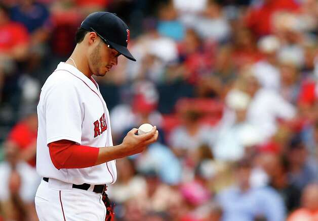 BOSTON, MA - AUGUST 17:  Joe Kelly #56 of the Boston Red Sox takes a moment in between pitches against the Houston Astros during the game at Fenway Park on August 17, 2014 in Boston, Massachusetts.  (Photo by Jared Wickerham/Getty Images) ORG XMIT: 477588161 Photo: Jared Wickerham / 2014 Getty Images