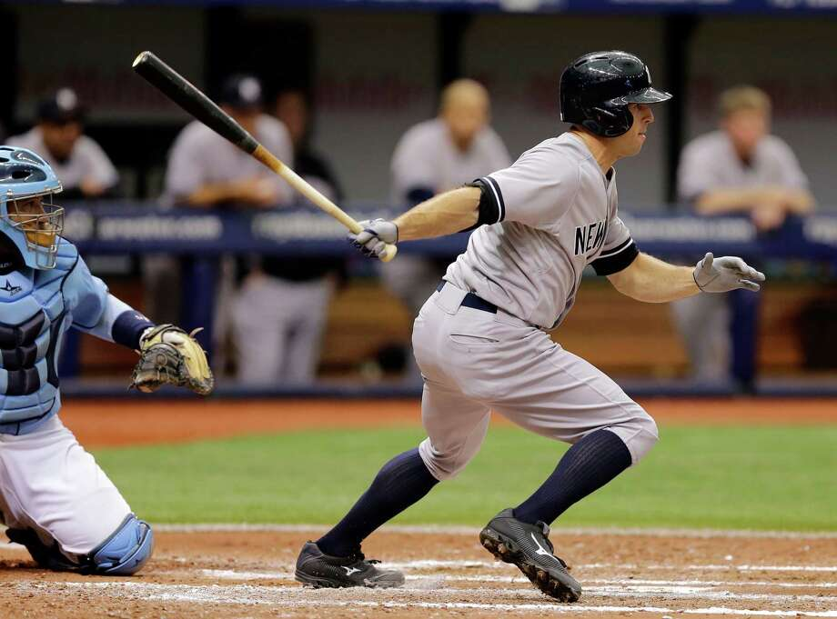 New York Yankees' Brett Gardner lines a two-run single off Tampa Bay Rays starting pitcher Jeremy Hellickson during the fifth inning of a baseball game Sunday, Aug. 17, 2014, in St. Petersburg, Fla. Yankees' Stephen Drew and Martin Prado scored on the hit. Catching for the Rays is Jose Molina. (AP Photo/Chris O'Meara)  ORG XMIT: SPD107 Photo: Chris O'Meara / AP