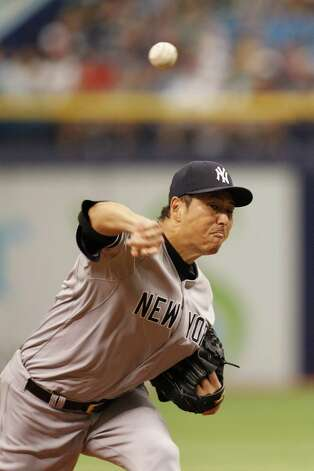 ST PETERSBURG, FL - AUGUST 17: Hiroki Kuroda #18 of the New York Yankees pitches during the first inning against the Tampa Bay Rays at Tropicana Field on August 17, 2014 in St Petersburg, Florida.  (Photo by Scott Iskowitz/Getty Images) ORG XMIT: 477588165 Photo: Scott Iskowitz / 2014 Getty Images