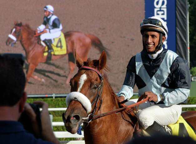 Jockey Rajiv Maragh smiles as he returns to the winners circle with Main Sequence after winning the 40th running of The Sword Dancer Sunday afternoon at the Saratoga Race Course Aug. 17, 2014 in Saratoga Springs, N.Y.   (Skip Dickstein/Times Union) Photo: SKIP DICKSTEIN