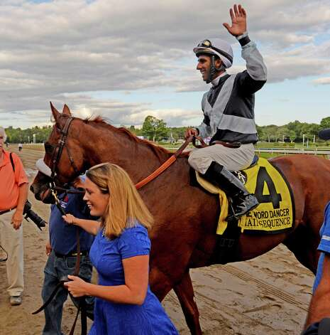 Jockey Rajiv Maragh waves to the crowd as he enters the winners circle with Main Sequence after winning the 40th running of The Sword Dancer Sunday afternoon at the Saratoga Race Course Aug. 17, 2014 in Saratoga Springs, N.Y.   (Skip Dickstein/Times Union) Photo: SKIP DICKSTEIN