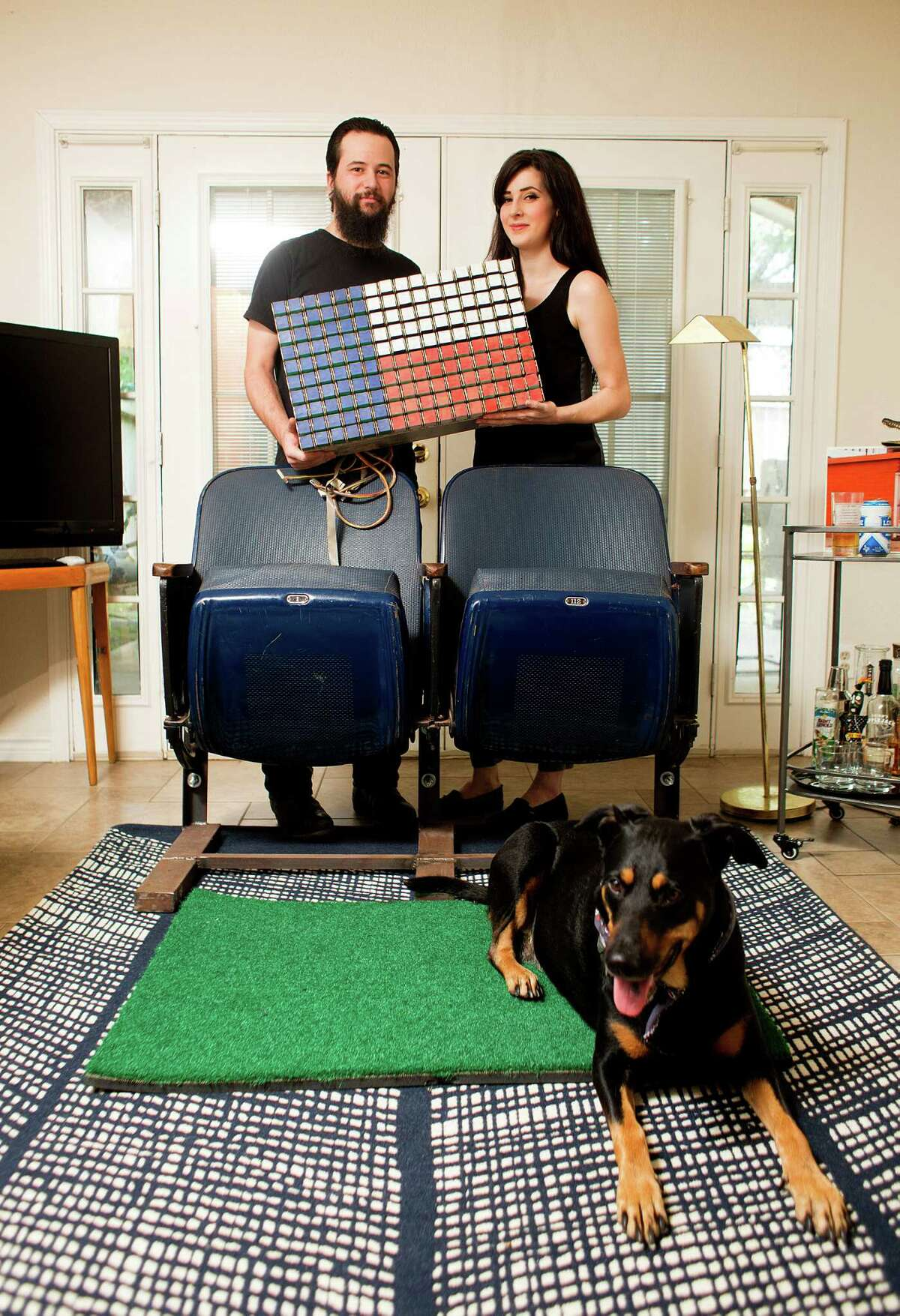 Megan Ross, 30, and Brad Corona, 28 - and their Ruby - show off their salvaged iconic Astrodome memorabilia.