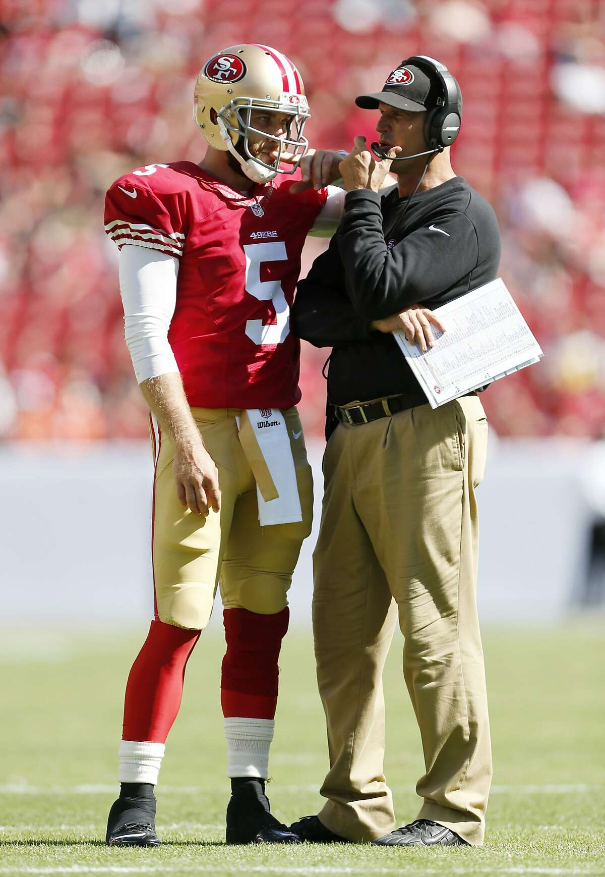 San Francisco 49ers head coach Jim Harbaugh, right, talks with quarterback McLead Bethel-Thompson during the fourth quarter of their game against the Denver Broncos on Sunday, August 17, 2014 in Santa Clara, Calif.