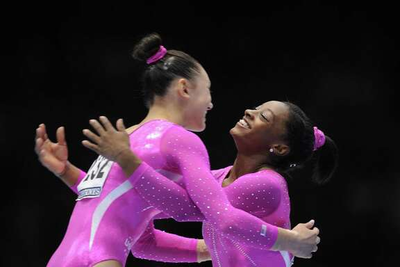 Simone Biles, right, is known for being outgoing toward her competitors, like fellow American Kyla Ross after they finished 1-2 in the world all-around in 2013.