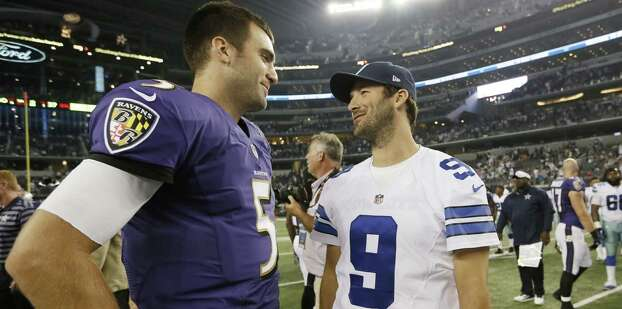 Baltimore Ravens quarterback Joe Flacco (5) and Dallas Cowboys quarterback Tony Romo (9) talk after an NFL preseason football game Saturday, Aug. 16, 2014, in Arlington, Texas. The Ravens won 37-30. (AP Photo/Brandon Wade) Photo: Brandon Wade, Associated Press / FR168019 AP