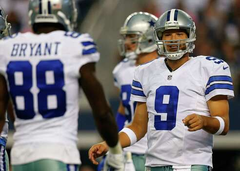 ARLINGTON, TX - AUGUST 16:  Tony Romo #9 of the Dallas Cowboys talks with Dez Bryant #88 of the Dallas Cowboys between plays against the Baltimore Ravens in the first half of their preseason game at AT&T Stadium on August 16, 2014 in Arlington, Texas. Photo: Tom Pennington, Getty Images / 2014 Getty Images