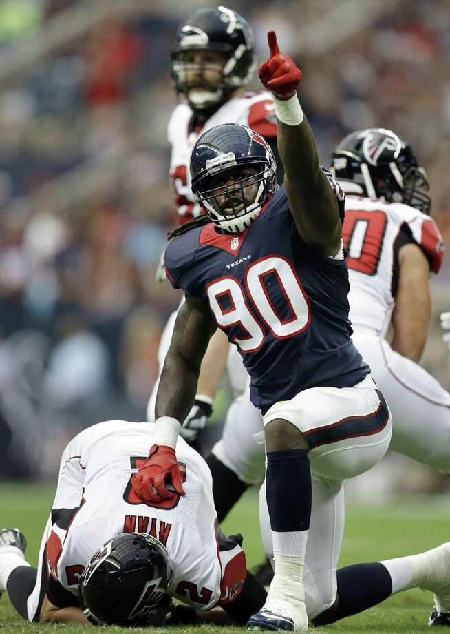 Jadeveon Clowney (90), the No. 1 overall pick, headlined the stellar showings by the Texans' rookies in a 32-7 preseason win over the Falcons on Saturday. Clowney sacked QB Matt Ryan and had another hit behind the line of scrimmage. Photo: Patric Schneider / Associated Press / FR170473 AP