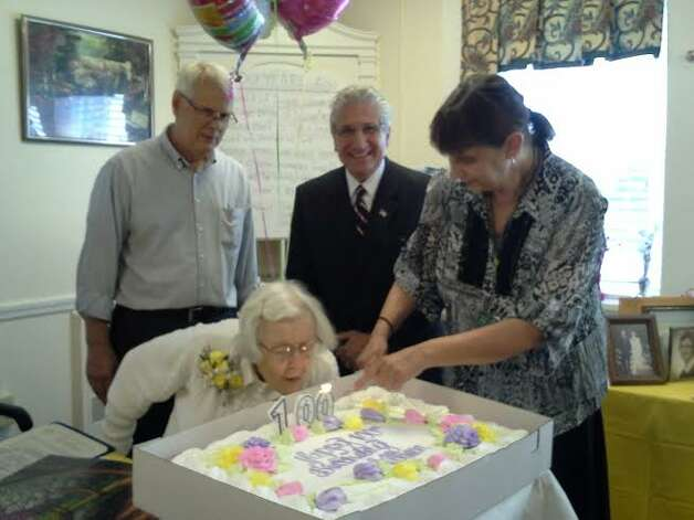Lillian Rowell of Schenectady marks her 100th birthday at the Heritage Home for Women in Schenectady with, from left, Chandler Rowell, Assemblyman Jim Tedisco and Jean Carmichael of the Heritage Home. Born Aug. 11, 1914 in Nova Scotia, Lillian married her late husband George, and through the years they became the proud parents of George, Jr., Caroline and Chandler. She also has six grandchildren and five great-grandchildren with a sixth on the way. (Adam Kramer)