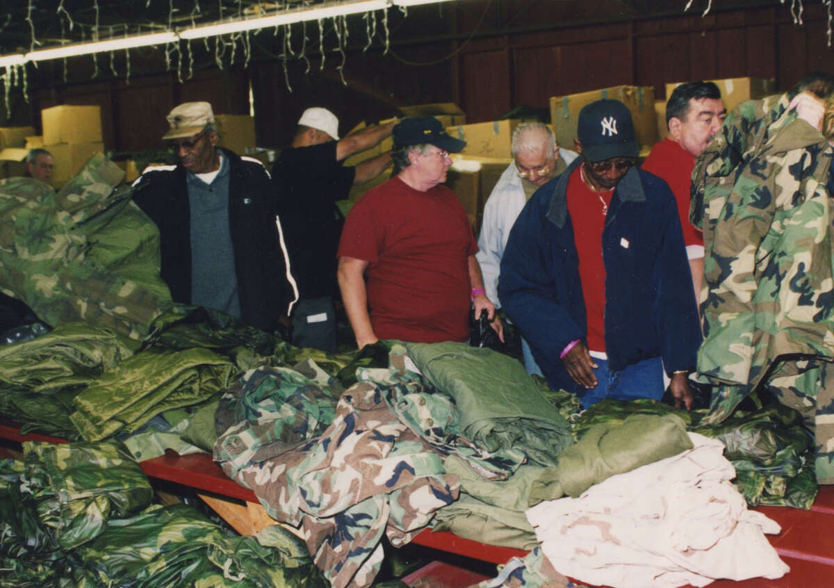 Volunteers look over a selection of clothing during an Eastern New York State Homeless Veterans Coalition's Homeless Veterans Stand-Down in 2012 at the Colonie Elks Lodge in Latham.