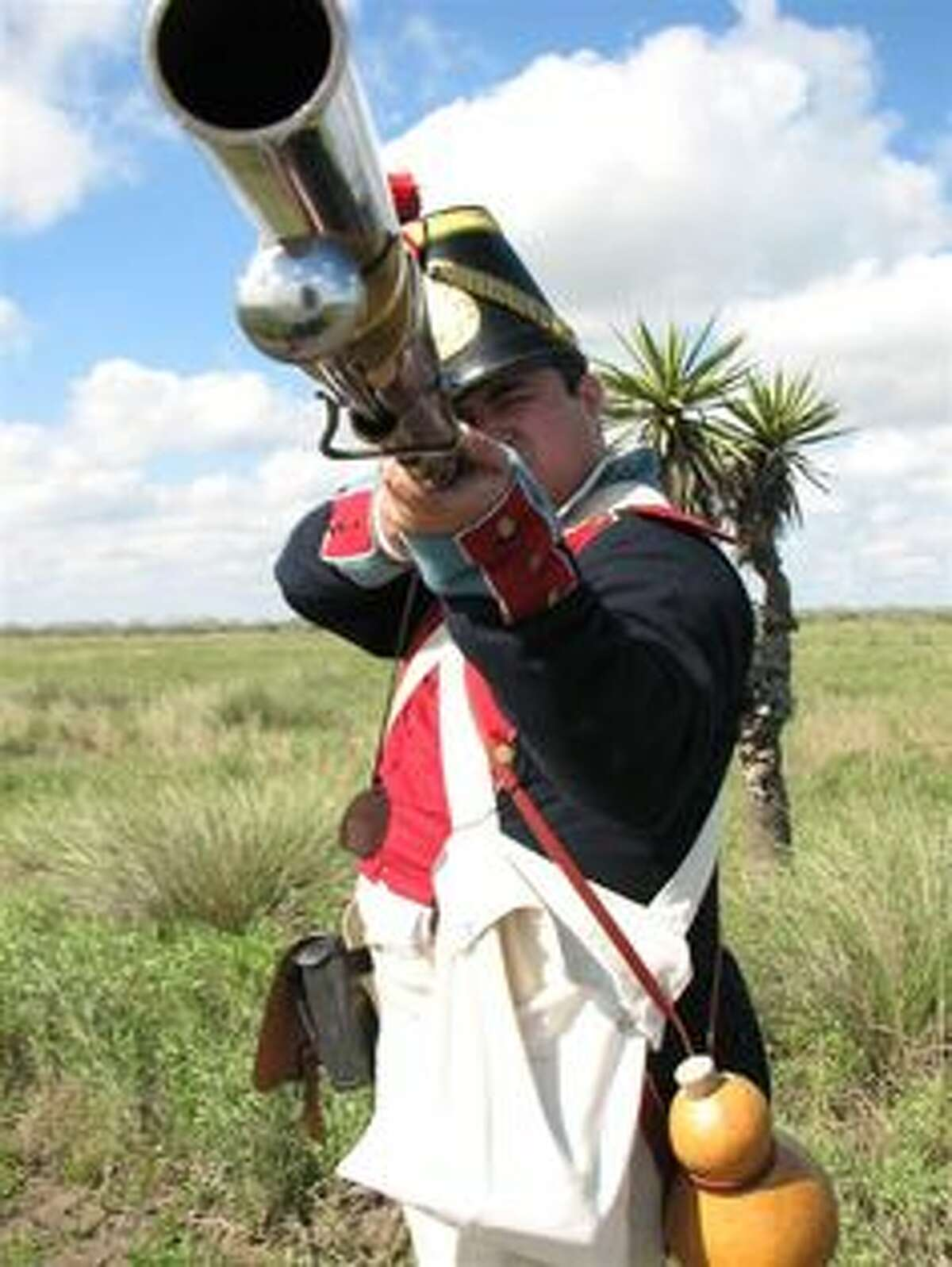 A Soldado aims a musket during a re-enactment at Palo Alto Battlefield National Historical Park in Brownsville.