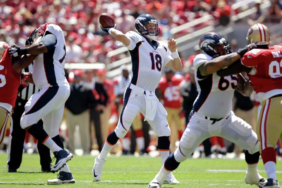 SANTA CLARA, CA - AUGUST 17:  Quarterback Peyton Manning #18 of the Denver Broncos throws a touchdown against the San Francisco 49ers during a preseason game at Levi's Stadium on August 17, 2014 in Santa Clara, California.  (Photo by Ezra Shaw/Getty Images) ORG XMIT: 501352669 Photo: Ezra Shaw / 2014 Getty Images