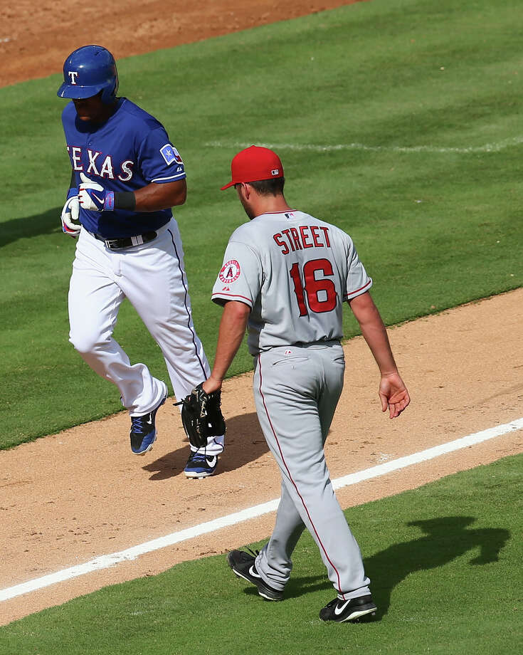 ARLINGTON, TX - AUGUST 17:  Huston Street #16 of the Los Angeles Angels walks off the field after giving up a run in front of Adrian Beltre #29 of the Texas Rangers in the ninth inning at Globe Life Park in Arlington on August 17, 2014 in Arlington, Texas.  (Photo by Ronald Martinez/Getty Images) ORG XMIT: 477588189 Photo: Ronald Martinez / 2014 Getty Images