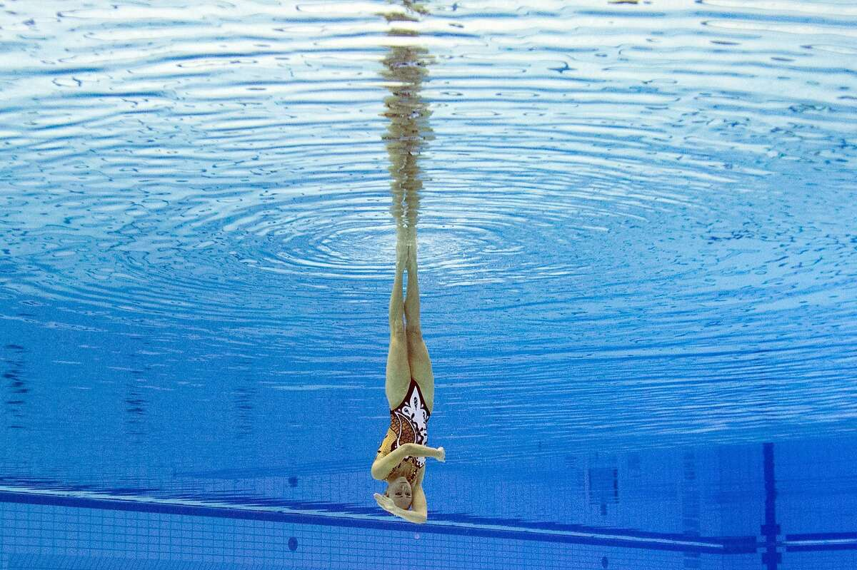 Solo synchronized swimming is an oxymoron: Bronze medalist Ukraine Anna Voloshyna competes in the synchronized swimming solo free final event at the European Swimming Championships in Berlin.
