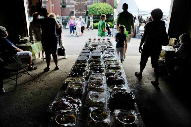 People check out the baked goods for sale at the Schenectady Polish American Festival at Saint Adalberts Church on Sunday, Aug. 17, 2014, in Schenectady, N.Y.  This is the 29th year of the festival for the church which is over 100 years old.  Volunteers cooked up 4,200 pierogis and 1,200 kielbasa and 1,200 golabki for the two-day event.  The festival is the largest fund raising event for the church which has 650 families as members.   (Paul Buckowski / Times Union) Photo: Paul Buckowski / 00028202A