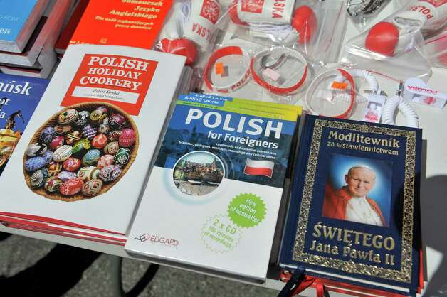 A view of items for sale at the QuoVadis Book Store and Gift Shop booth at the Schenectady Polish American Festival at Saint Adalberts Church on Sunday, Aug. 17, 2014, in Schenectady, N.Y.  This is the 29th year of the festival for the church which is over 100 years old.  Volunteers cooked up 4,200 pierogis and 1,200 kielbasa and 1,200 golabki for the two-day event.  The festival is the largest fund raising event for the church which has 650 families as members.   (Paul Buckowski / Times Union) Photo: Paul Buckowski / 00028202A